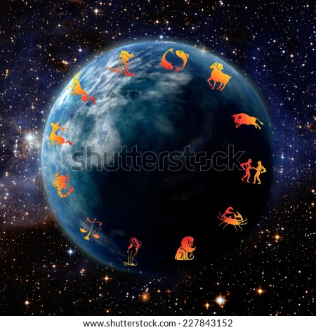 astrology symbols around the planet earth - stock photo