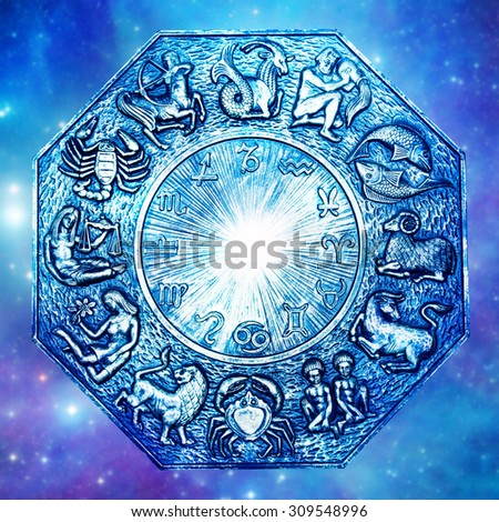 astrology wheel with signs symbols and flare in the center   - stock photo