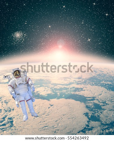 "Astronaut against earth in the outer space. Sun lightning. ""The elements of this image furnished by NASA"""