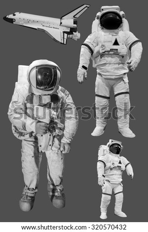 Astronaut and space shuttle Isolated on grey background - stock photo