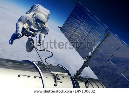 Astronaut and space station in space. - stock photo