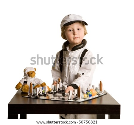 astronaut boy plays chess on white background