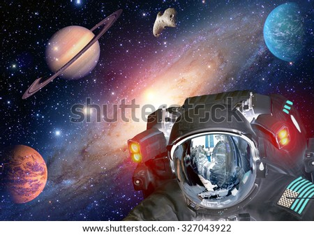 Astronaut et extraterrestrial alien spaceman helmet outer space planet. Elements of this image furnished by NASA. - stock photo