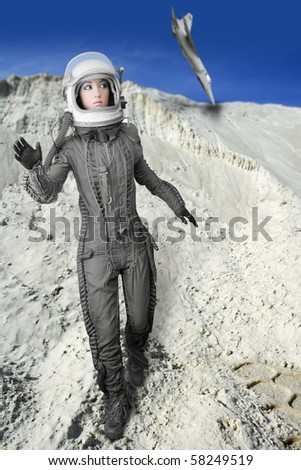 astronaut fashion woman aircraft crash space suit helmet moon landscape [Photo Illustration] - stock photo