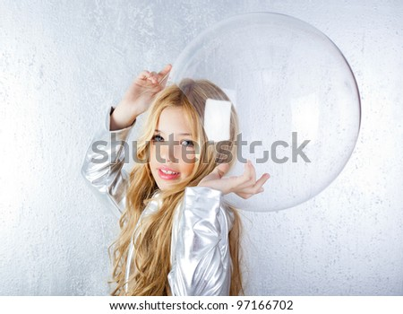 Astronaut futuristic kid girl with silver uniform and glass helmet - stock photo