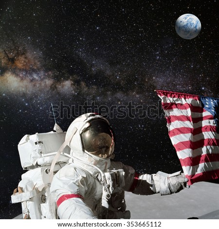 Astronaut holding American flag on lunar (moon) landing mission. Elements of this image furnished by NASA. - stock photo