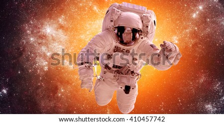 Astronaut in outer space against the backdrop of the stars nebula background. Elements of this image furnished by NASA. - stock photo