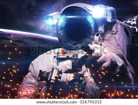 Astronaut in outer space. Elements of this image furnished by NASA. - stock photo