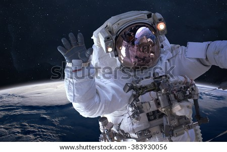 Astronaut in outer space. Spacewalk. Elements of this image furnished by NASA - stock photo
