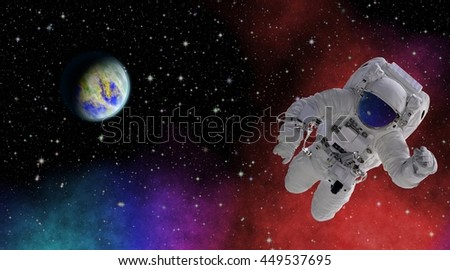 Astronaut in space with an unknown planet. Discovering the mysterious parts of the universe. Elements of this image furnished by NASA.