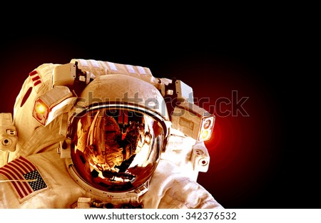 Astronaut mars helmet isolated on black background spaceman outer space suit. Elements of this image furnished by NASA. - stock photo