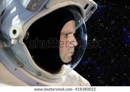 Astronaut on space mission with stars on the background. Portrait of cosmonaut with spacesuit in space. - stock photo