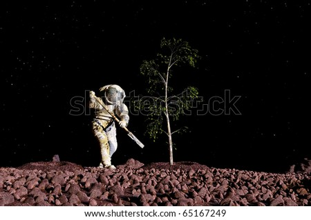 Astronaut planting a tree on the planet - stock photo