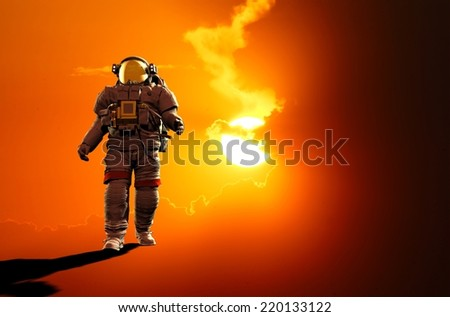 Astronaut run on a red background. - stock photo