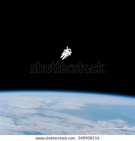 Astronaut space walking from Shuttle in outer space. Earth in the background. Elements of this image furnished by NASA.