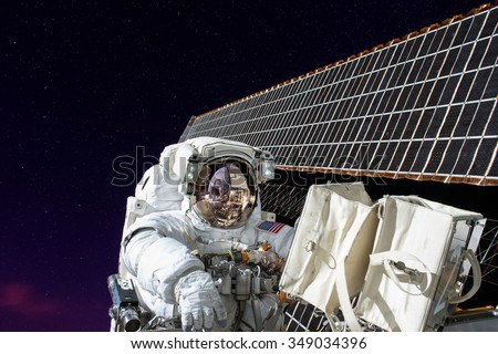 Astronaut space walking from Shuttle in outer space. Elements of this image furnished by NASA. - stock photo