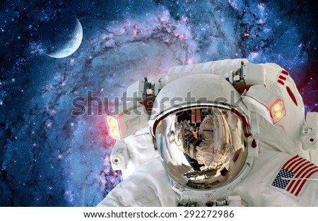 Astronaut spaceman helmet light outer space universe selfie moon. Elements of this image furnished by NASA. - stock photo