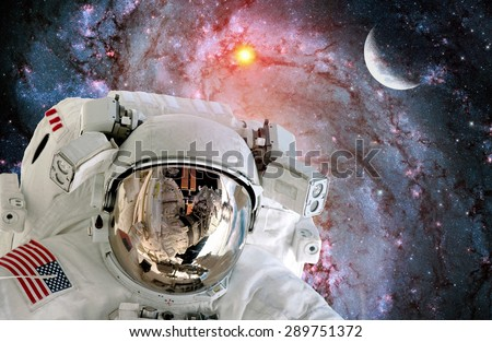 Astronaut spaceman helmet outer space scene universe galaxy moon. Elements of this image furnished by NASA. - stock photo