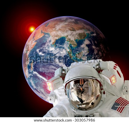 Astronaut spaceman isolated helmet outer space earth globe sunrise. Elements of this image furnished by NASA. - stock photo