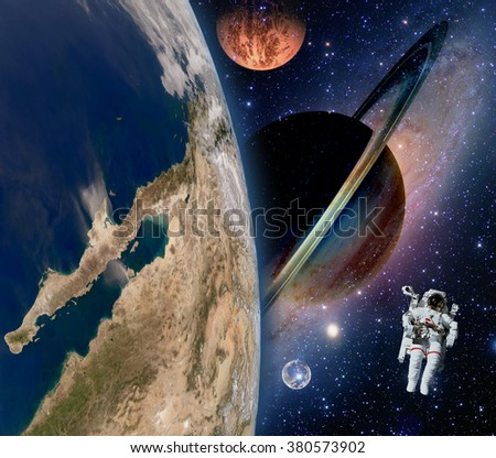 Astronaut spaceman mars saturn planet spacewalk earth outer space walk galaxy. Elements of this image furnished by NASA.