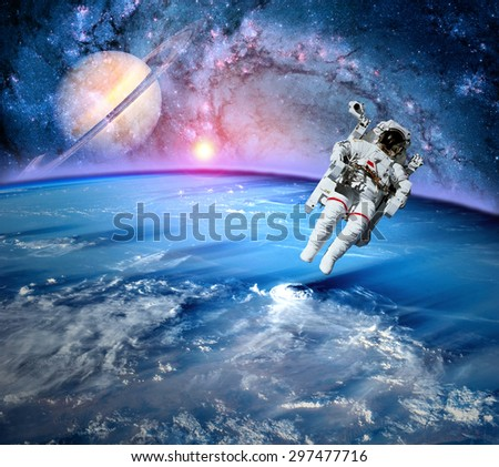 Astronaut spaceman outer space solar system saturn earth sun. Elements of this image furnished by NASA.