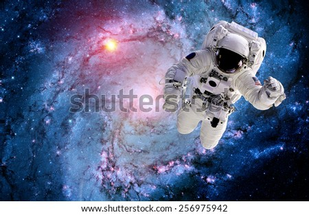 Astronaut spaceman outer space suit galaxy spiral stars. Elements of this image furnished by NASA. - stock photo