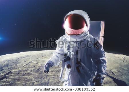 Astronaut standing on the moon - stock photo