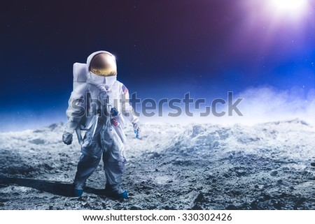 "Astronaut standing on the moon ""Elements of this image were NOT furnished by NASA"" - stock photo"
