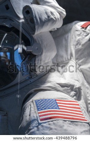 Astronaut suit with American Flag patch on shoulder - stock photo