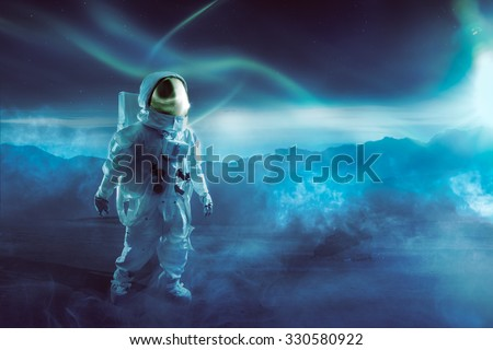 "Astronaut walking on an unexplored planet ""Elements of this image were furnished by NASA"" - stock photo"