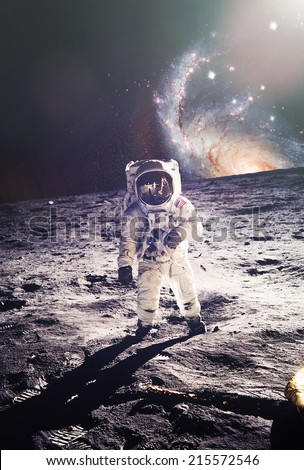 Astronaut walking on moon with galaxy background. Elements of this image furnished by NASA - stock photo