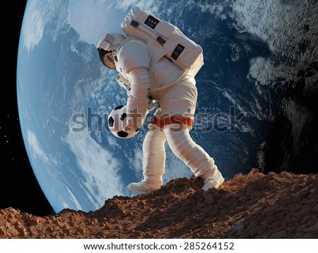 "Astronaut with Ball in hand on the background of the Earth..""Elements of this image furnished by NASA"" - stock photo"