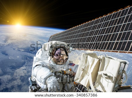 Astronaut work on the space station - Elements of this image furnished by NASA - stock photo