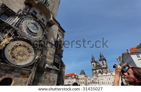 Astronomical Clock in Prague and the Church of the Virgin Mary - stock photo
