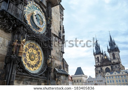 Astronomical clock of in Old Town of Prague with Tyn church at the background  - stock photo