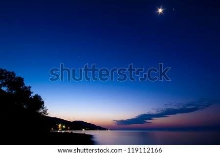 Astronomical Twilight With The Moon And Jupiter Above - stock photo