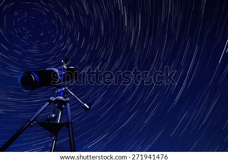 Astronomy - Star Trails in the early Spring sky in North Yorkshire in the United Kingdom. The star trails appear to rotate around Polaris, the Pole Star. - stock photo