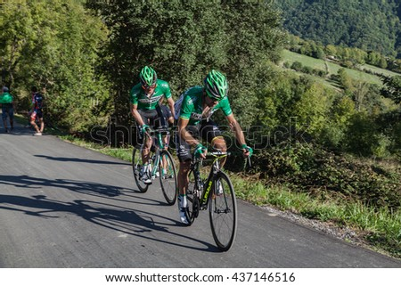 "ASTURIAS, SPAIN. September 07th 2015. David Arroyo Duran and a teammate climbing to Ermita del Alba in the last meters of the 16th stage of ""La Vuelta"""