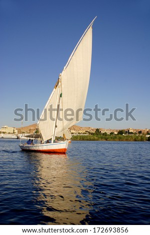 ASWAN  EGYPT NOV 25: Felucca sails on the Nile river near Aswan, Egypt on nov. 25 2010.The feluccas seen today were invented in 3350 BC