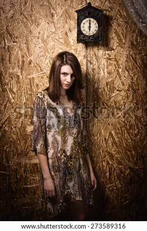 Asylum. Lonely mad woman in a dark room. Low key. - stock photo