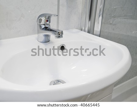 asymmetric hand wash basin with chrome tap over - stock photo