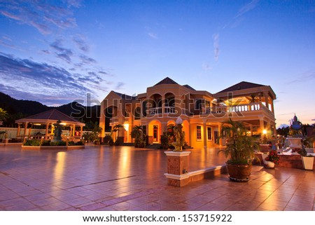 at a luxury  resort at night, dawn time Resort and house - stock photo