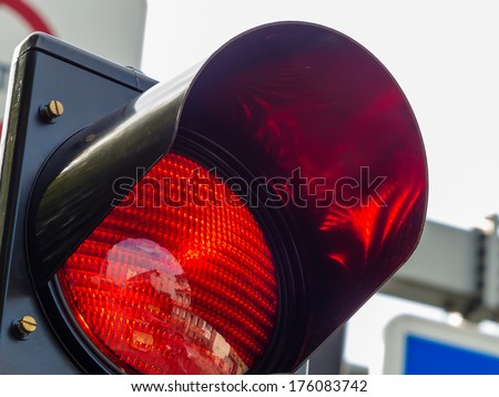at a traffic light, the red light is lit. symbolic photo for holding - stock photo