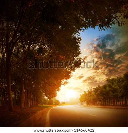 At dusk highway in the village. - stock photo