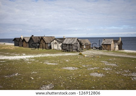 At Faro, an island at Gotland, Sweden, there is a very old, small village of fishermens cabins. This is called Helgumannen. - stock photo