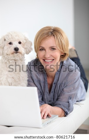 at home laptop, with pet dog