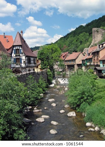 At 8 km from Colmar, Kaysersberg is a famous tourist centre with medieval architecture. - stock photo