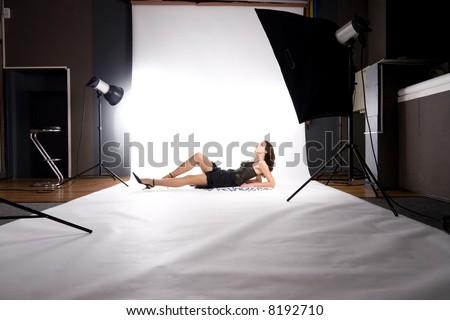 At photo studio. Making photo on white. - stock photo