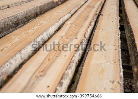 At sawmill. Image of wooden boards lying in row