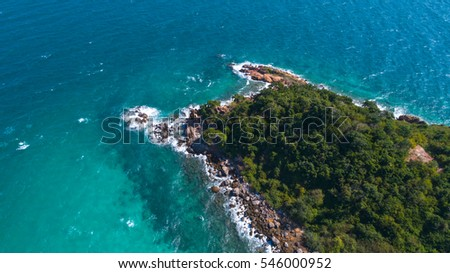 At Sea Island.Aerial view. Top view.amazing nature background.The color of the water and beautifully bright.Azure beach with rocky mountains and clear water of Thailand ocean at sunny day.Koh Lan.